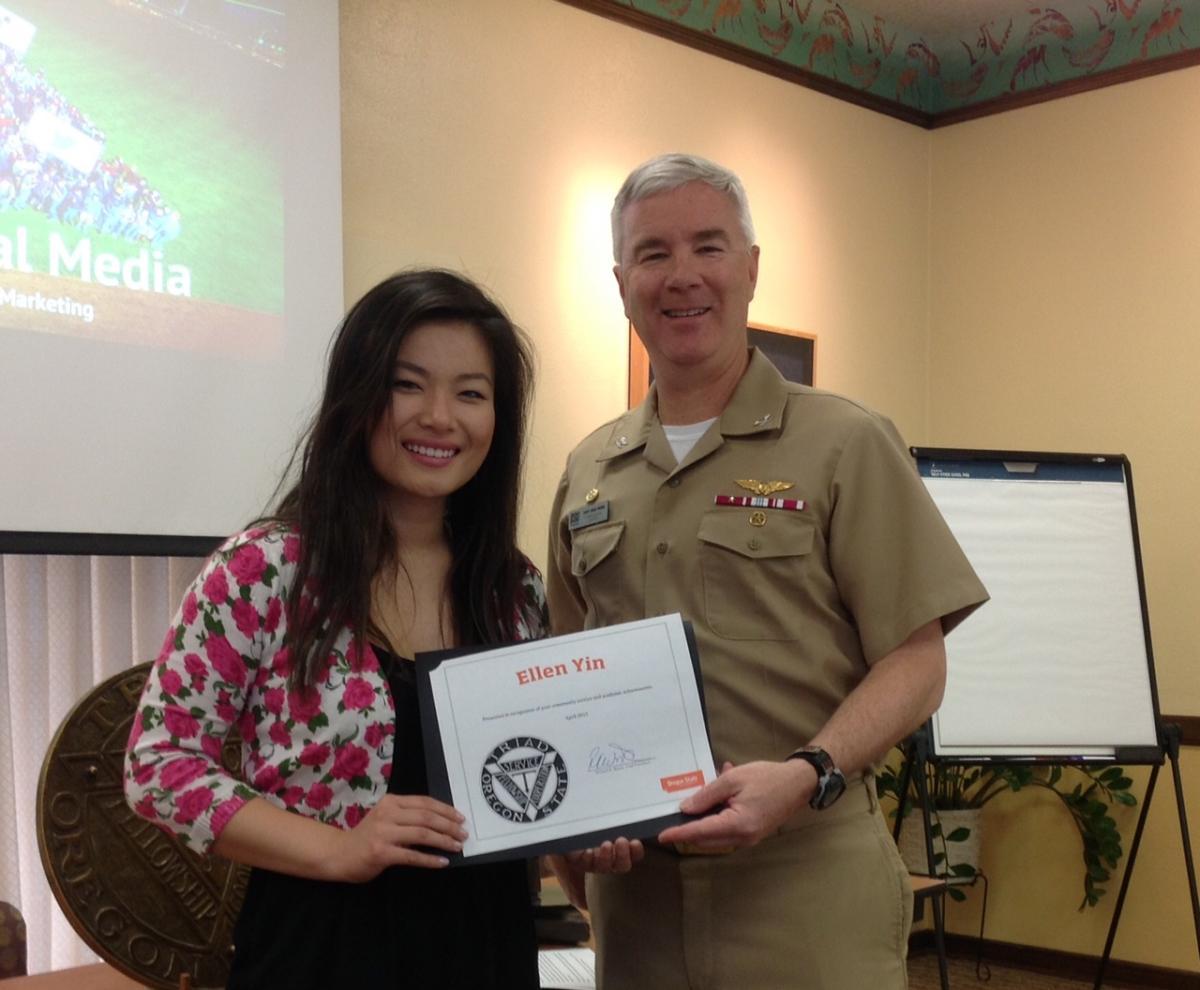Ellen Yin receives a Triad scholarship from Richard Wood, Triad president for 2015